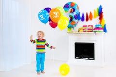 Little boy opening birthday presents Royalty Free Stock Photo