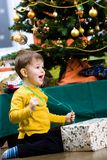 Little boy opening Chrismas present Stock Photos