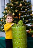 Little boy opening Chrismas present Royalty Free Stock Photography