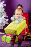 Little Boy Opening Christmas Present Royalty Free Stock Photography