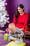 Little Boy Opening Christmas Present Royalty Free Stock Photos