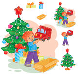 Little boy opening Christmas presents Stock Images