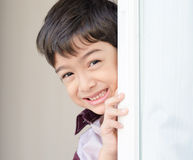 Little boy opening the door curtain Royalty Free Stock Images