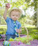 Little Boy Opening Easter Eggs Outside in Park Royalty Free Stock Photo