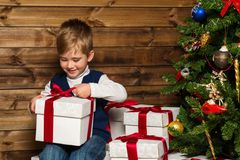 Little boy opening gift box Stock Photo