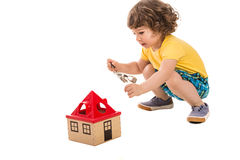 Little boy opening house toy Stock Image