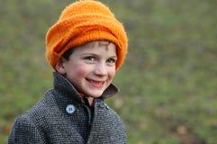 Little boy in orange woollen hat. Close-up portrait of boy in orange hat Royalty Free Stock Photo