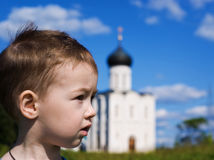 Little boy on a  orthodox church background Stock Photo