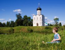 Little boy on a  orthodox church background Stock Image