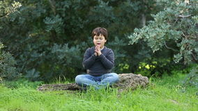 Little boy  outdoor praying and meditating stock footage