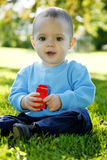 Little boy outdoors. Adorable little boy playing in a park royalty free stock photos