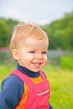 Little boy outdoors. A smiling little boy outdoors Stock Photo