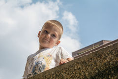 Little boy outdoors. And blue sky Stock Photos