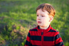 Little boy outdoors. A charming little boy outdoors in spring Royalty Free Stock Photos
