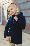 Little Boy outdoors in city on beautiful spring day.  Royalty Free Stock Image