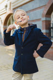 Little Boy outdoors in city on beautiful spring day.  Stock Photography