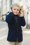 Little Boy outdoors in city on beautiful spring day.  Royalty Free Stock Images