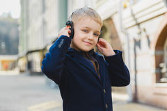 Little Boy outdoors in city on beautiful spring day.  Royalty Free Stock Photography