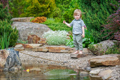 Little boy outdoors fishing Royalty Free Stock Images