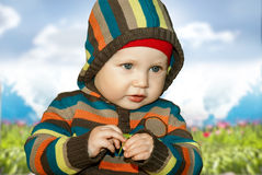 Little boy outdoors. stock photo