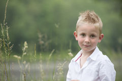 Little boy outdoors. Portrait of a little boy outdoors Royalty Free Stock Photo