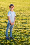 Little boy outdoors smiling in the park. At summer Stock Images