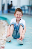 Little boy outdoors at summer. Casual portrait of cute little boy outdoors on summer day Royalty Free Stock Images