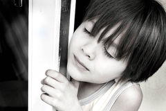 Little boy outside. Portrait of a little boy by a balcony door Royalty Free Stock Image