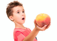 Little boy outstretch the peach Stock Photography