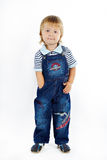 The little boy in overalls. The clever little boy in overalls Stock Photos
