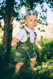 The little boy in overalls and a cap Stock Photos