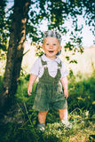 The little boy in overalls and a cap Royalty Free Stock Images