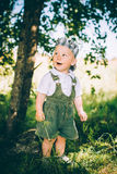 The little boy in overalls and a cap Royalty Free Stock Photography