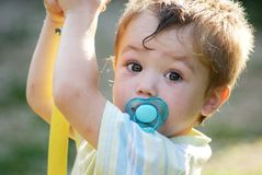 Little boy with pacifier. Little boy 2 years old with blue pacifier Royalty Free Stock Photos