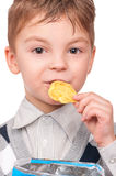 Little boy with packet potato chips Royalty Free Stock Photos