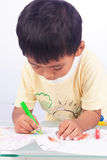 Little boy paint color on white paper on white backgroun Royalty Free Stock Photography