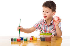 Little boy paint easter eggs Royalty Free Stock Photography