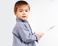 Little boy with paintbrush Stock Images