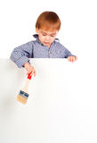 Little boy with a paintbrush Royalty Free Stock Images