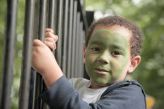 Little boy with a painted face Stock Photos