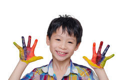 Little boy with painted hands. Little Asian boy with painted hands over white background royalty free stock image
