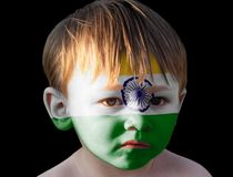 Little boy with painted Indian flag stock photo