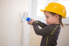 Little boy painted the wall stock image