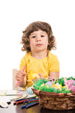 Little boy painting Easter eggs Stock Images