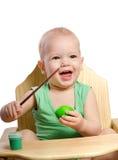 Little boy  painting egg Stock Photos