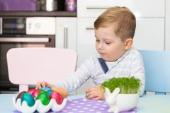 Little boy painting eggs for Easter. Morning Royalty Free Stock Images
