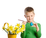 Little boy painting eggs for easter royalty free stock photos