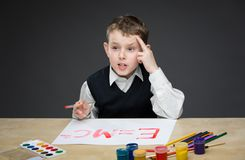 Little boy painting energy formula Royalty Free Stock Photo