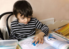 Little boy  painting with fingers Stock Photo