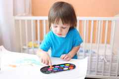 Little boy painting with fingers Royalty Free Stock Image
